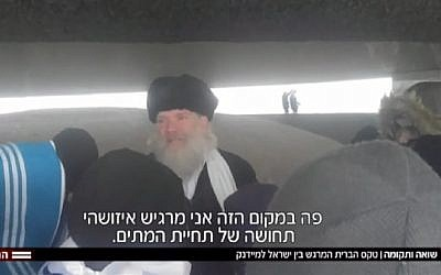 Screen capture from video of Rabbi Aryeh Hendler leading a tour at the Majdanek concentration camp site in Poland, November 2017. (Hadashot news)