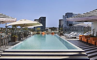 The rooftop pool and lounging area at Publica, the new Isrotel business hotel in Herzliya (Courtesy, Assaf Pinchuk)