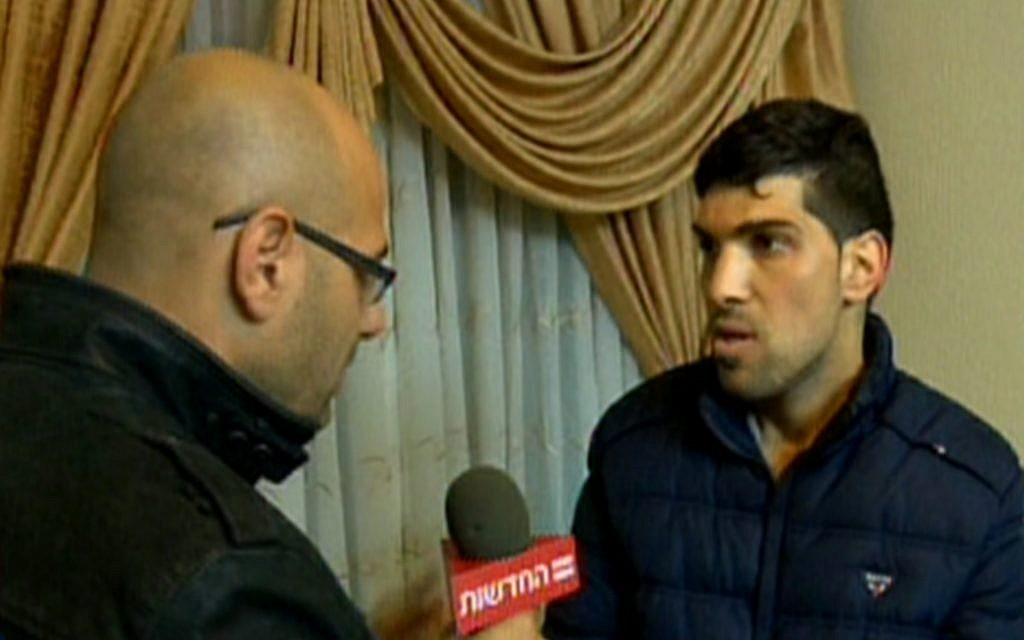 Faisal el-Natche, a Hebron resident said to have been beaten by Israeli soldiers in 2014, speaks to Channel 2 (screenshot)