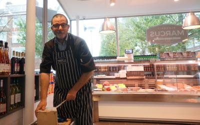 Nissim Guedj unpacking merchandise at a kosher meat shop in Amsterdam, October 26, 2017. (Cnaan Liphshiz/JTA)