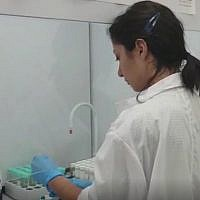 Screen capture from video showing a technician testing for banned substances in a laboratory at the Kerem Shalom border crossing with the Gaza Strip. (Defense Ministry)