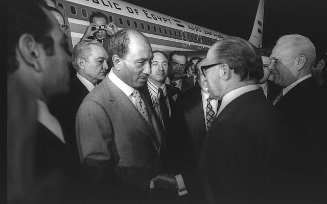 Prime minister Menachem Begin welcomes Egyptian president Anwar Sadat at Ben Gurion Airport on November 19, 1997 (Moshe Milner/GPO archive)