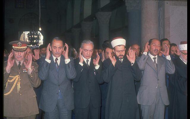 Egyptian president Anwar Sadat prays at the al-Aqsa mosque in Jerusalem on November 20, 1977 (Miki Tzarfati/GPO archive)