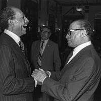 Israeli prime minister Menachem Begin (R) and Egyptian president Anwar Sadat share a laugh at the King David Hotel on November 19, 1977. (Ya'akov Sa'ar/GPO archive)