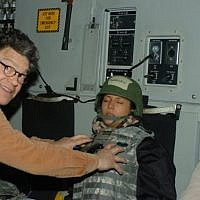 A photograph released be Leeann Tweeden on November 16, 2017, which shows her sleeping on board an aircraft, with Al Franken shown reaching out as if to grope her breasts (Twitter)