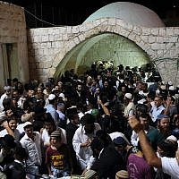 Illustrative. Hundreds of ultra-Orthodox Jewish men pray near the compound of Joseph's Tomb in the West Bank city of Nablus on June 10, 2013. ( Yaakov naumi / Flash90 )