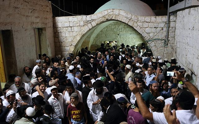 Hundreds of ultra Orthodox Jewish men pray near the compound of Joseph's Tomb in the West Bank city of Nablus early on June 10, 2013. ( Yaakov naumi / Flash90 )