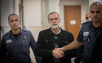 Rabbi David Harison is brought for a hearing at the Jerusalem District Court on December 18, 2016. (Yonatan Sindel/Flash90)