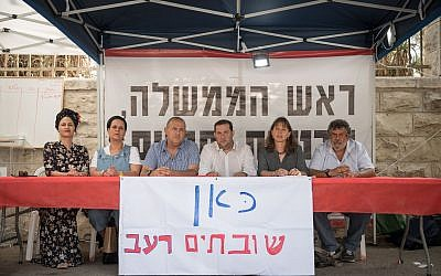 Shomron regional council head Yossi Dagan, Beit Aryeh regional council Avi Naim and Hadas Mizrahi at a protest tent set up outside the Prime Minister's Residence in Jerusalem on November 5, 2017. (Hadas Parush/Flash90)