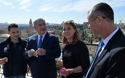 Prime Minister Benjamin Netanyahu, second left, and Tourism Minister Yariv Levin, right, seen with Israel's 3,000,000th visitor this year, Ioana Isac, second right, and her partner, Mihai Georgescu from Romania, at the Tower of David Museum in the Old City of Jerusalem, November 7, 2017. (Kobi Gideon/GPO)