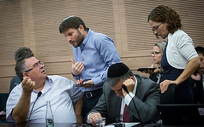 Coalition chairman Likud MK David Bitan, left, with Jewish Home MK Bezalel Smotrich, second left, during a meeting of the Finance Committee in the Knesset, November 6, 2017. (Miriam Alster/Flash90)