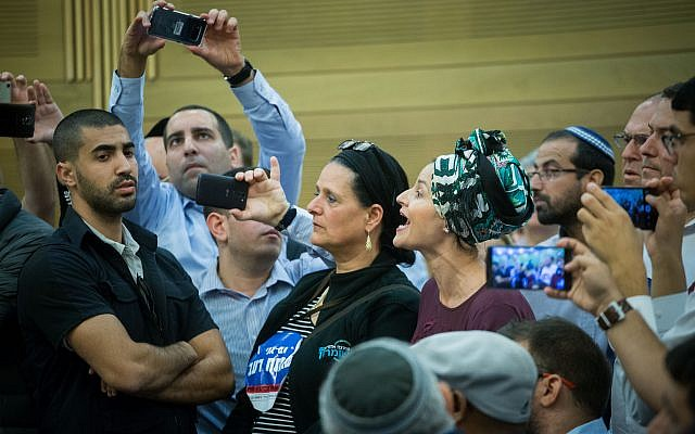 Adva Biton, mother of Adele Biton, who was injured at a terror attack and died later from her wounds, reacts during a Likud party faction meeting at the Knesset on November 6, 2017. (Miriam Alster/Flash90)