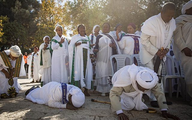 Members of the Ethiopian Jewish community in Israel take part in a prayer of the Sigd holiday on Armon Hanatziv Promenade overlooking Jerusalem on November 16, 2017. (Hadas Parush/Flash90)