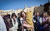 Members of the Reform movement hold Torah scrolls during a mixed men and women prayer at the public square in front of the Western Wall, in Jerusalem's Old City, November 16, 2017. (Noam Rivkin Fenton)