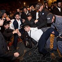 Ultra-Orthodox Jewish men protest against the army draft, at the entrance to Jerusalem, November 19, 2017. (Yonatan Sindel/Flash90)