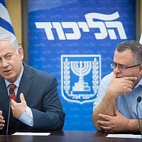 Prime Minister Benjamin Netanyahu (left) with coalition chairman David Bitan at a Likud faction meeting at the Knesset on November 27, 2017. (Miriam Alster/Flash90)