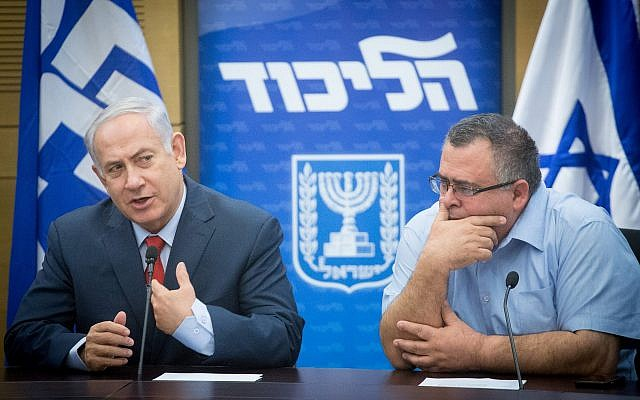 Prime Minister Benjamin Netanyahu with coalition chairman David Bitan attend a Likud faction meeting at the Knesset on November 27, 2017. (Miriam Alster/Flash90)