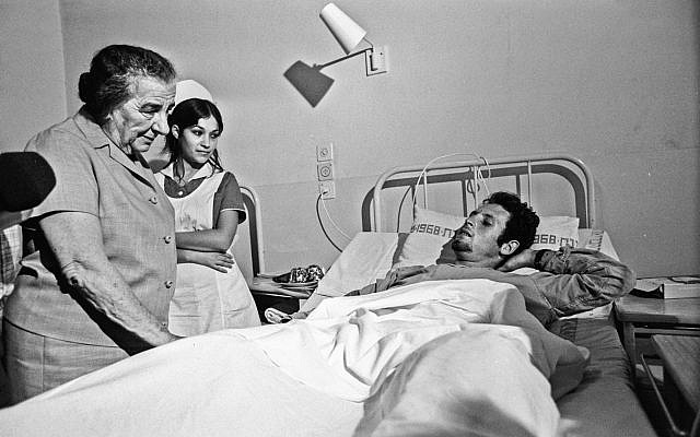 Then-prime minister Golda Meir visiting a wounded soldier in hospital during the 1973 Yom Kippur War. (Herman Chanania/GPO)