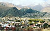 A view of Mount Kazbegi and the Gergeti Church overlooking the Georgian village of Kazbegi (Jessica Steinberg/Times of Israel)