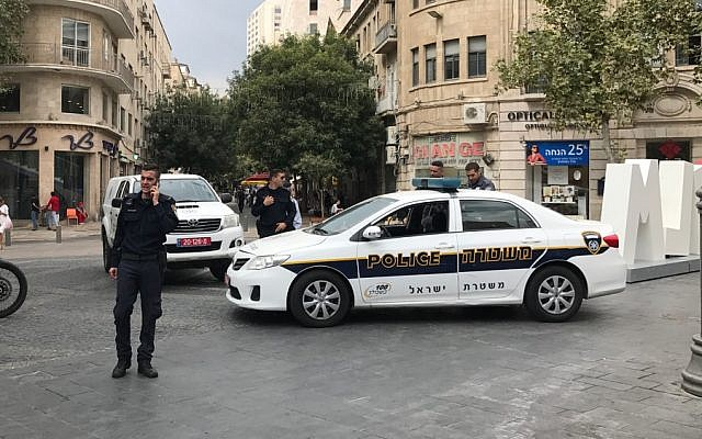 Illustrative: Police squad cars in Zion Square, downtown Jerusalem, September 20, 2017. (Stuart Winer/Times of Israel)