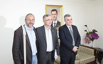 Jonathan Spyer (left) poses for a picture with Syrian Minister of Reconciliation Ali Haidar and Minister of Information, Mohammed Tourjeman (right), while on a government-sponsored tour of Damascus in April, 2017.
