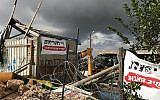A bulldozer demolishes a woodshop at the illegal Netiv Ha'avot outpost, November 29, 2017 (Jacob Magid/Times of Israel)