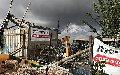 A bulldozer demolishes a woodshop at the illegal Netiv Ha'avot outpost, November 29, 2017 (Jacob Magid/Times of Israel)