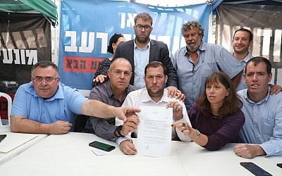 Settler leaders agree to a deal with the government to end their protest outside the Prime Minister's Residence in Jerusalem on November 10, 2017. From left to right: David Bitan, Beit Aryeh Mayor Avi Naim, MK Oren Hazan, Shomron Regional Council head Yossi Dagan, Itzhak Abutbul, Hadas Mizrahi, Kiryat Arba-Hebron Mayor Melachi Levinger. (Courtesy: Samaria Regional Council)