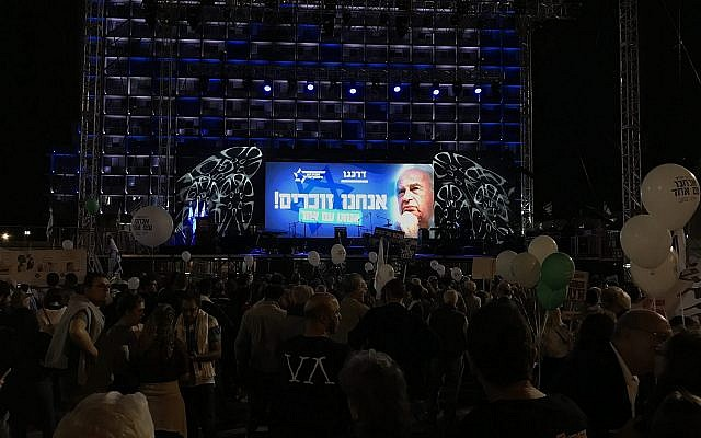 Israelis attend a rally marking 22 years since the assassination of prime Minister Yitzhak Rabin, at Tel Aviv's Rabin Square on November 4, 2017. (Jacob Magid/The Times of Israel)