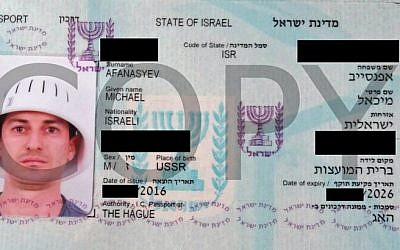Michael Afanasyev wearing a colander in a picture he said the Israeli interior ministry used in his passport. (Courtesy of Omroep West via JTA)