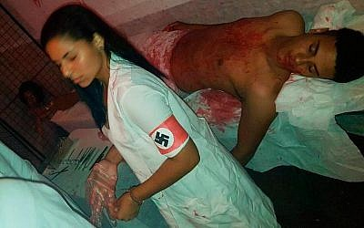 Students at Milecimo da Silva High School recently simulating Nazi human experiments in Rio De Janeiro, Brazil. (Screenshot from Facebook via JTA)