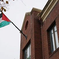 The Palestinian flag is seen above the offices of the Palestine Liberation Organization in Washington, DC, November 18, 2017. (MANDEL NGAN/AFP/Getty Images via JTA)