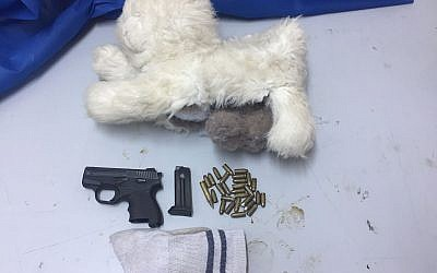 A pistol and ammunition hidden inside a toy dog found by security forces in the West Bank overnight October 31, 2017. (IDF spokesperson)