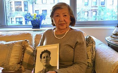 Rose Holm at her apartment holding a photo of her late husband, Joe, October 31, 2017. (Josefin Dolsten/JTA)