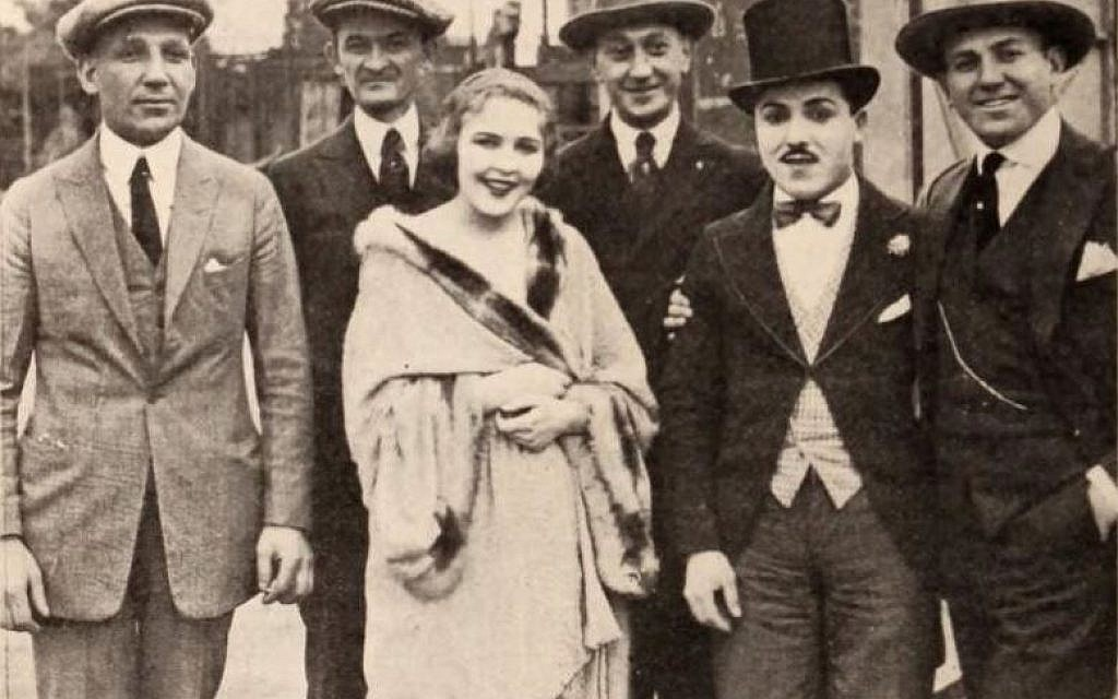 From left: Film producer Sam Warner, exhibitor Joe Marks from Youngstown, Ohio, actress Florence Gilbert, racing pilot Art Klein, comic actor Monty Banks, and film producer Jack Warner, on page 82 of the February 28, 1920 Exhibitors Herald. (Public domain)