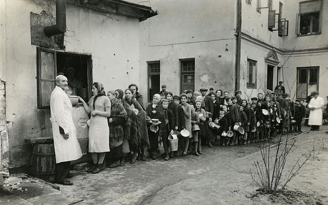 Jews are seen lining up in the Warsaw Ghetto during World War II. (Courtesy of American Jewish Joint Distribution Committee Archives via JTA)