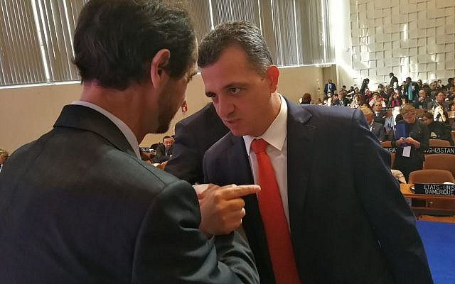 Israeli Ambassador to UNESCO Carmel Hacohen Shama, right, argues with a Palestinian diplomat during the agency's General Conference in Paris, November 2017 (courtesy)