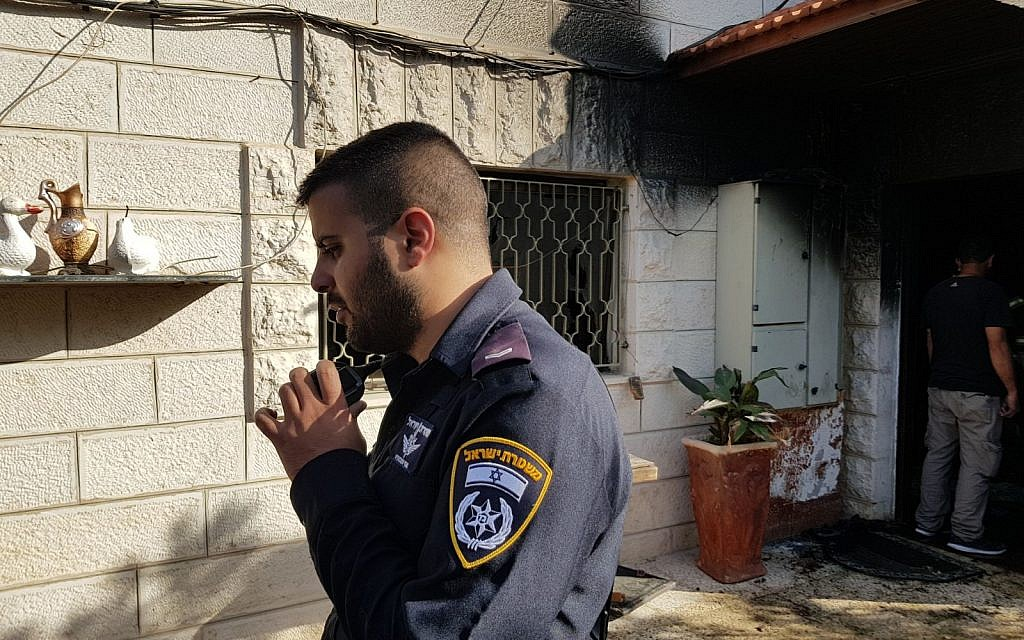 Police Sergeant Oshri Maman who rescued two children from an apartment fire in East Jerusalem's Beit Hanina neighborhood, November 14, 2017. (Israel Police)