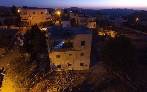The demolished home of a Palestinian terrorist in the village of Bayt Surik on November 15, 2017. (Israel Defense Forces)