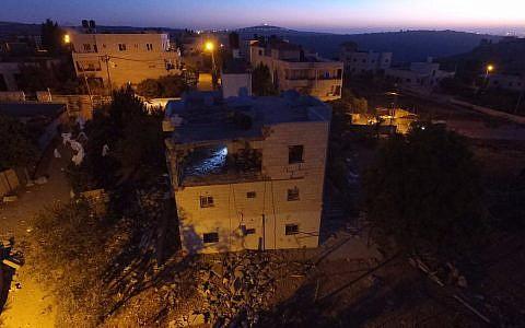 The demolished home of a Palestinian terrorist in the village of Bayt Surik on November 15, 2017. (Israel Defense Forces)