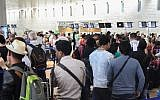 Thousands of people stand in line at Ben Gurion Airport's departure terminal on August 13, 2015, a day when 79,800 passengers passed through on 457 flights. (Flash90)