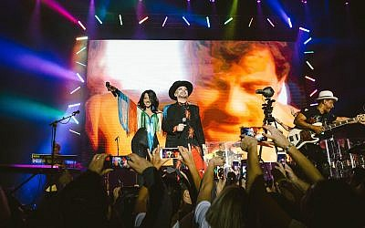 Israeli singer Dana International joins Boy George and Culture Club on stage at a November 7, 2017 show in Tel Aviv. (Courtesy)