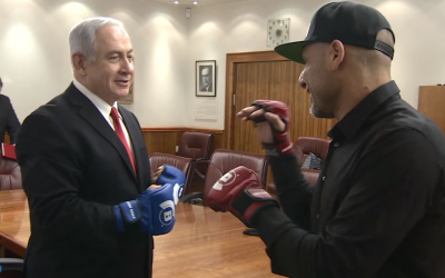 Prime Minister Benjamin Netanyahu spars with Israeli MMA fighter Noad Lahat at the Knesset on November 15, 2017. (Screen capture/YouTube)