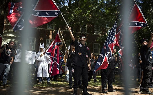 Ku Klux Klan members on July 8, 2017 in Charlottesville, Virginia protesting the planned removal of a statue of General Robert E. Lee, and calling for the protection of Southern Confederate monuments. (Chet Strange/Getty Images via JTA)