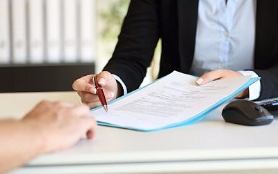 Illustrative photo of a work contract (Credit: AntonioGuillem, IStock by Getty Images)
