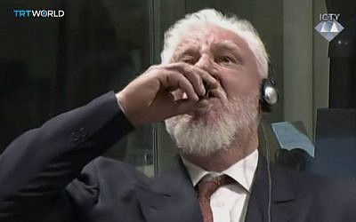 Slobodan Praljak drinks what appears to be a poison upon receiving a 20 year sentence in a UN war crimes court on November 29, 2017.