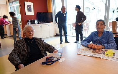 Henny Goudeketing, left, and Anne van de Geest at the main hall of the Immanuel Jewish hospice in Amsterdam, November 1, 2017. (Cnaan Liphshiz/via JTA)