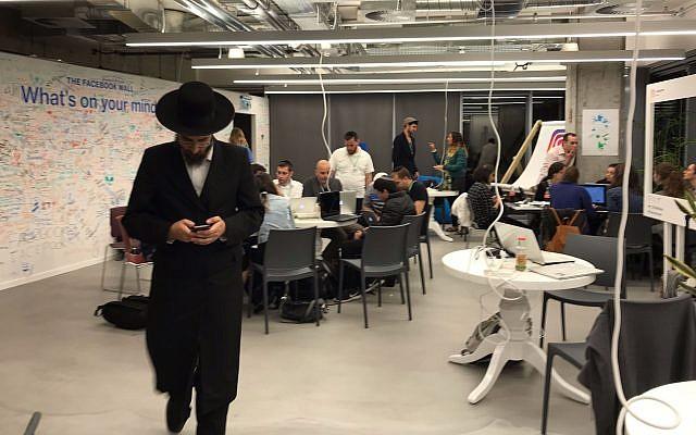 Haredi teams at work during Hackathon at Facebook offices in Tel Aviv; Nov. 16, 2017 (Shoshanna Solomon/TimesofIsrael)