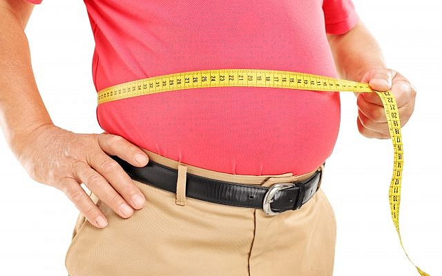 Illustrative: A man measures his belly. (Ljupco/ Stock via Getty images)