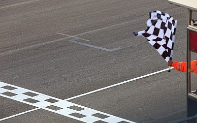A checkered flag waving at an car race. (iStock/Getty Images/AvigatorPhotographer)
